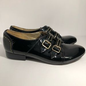 Libby. Edelman black Loafers with Buckle Accents